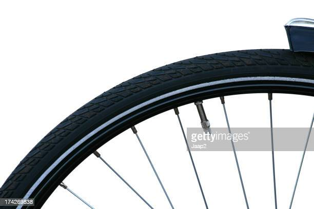 Front wheel of a bicycle, fragment on white