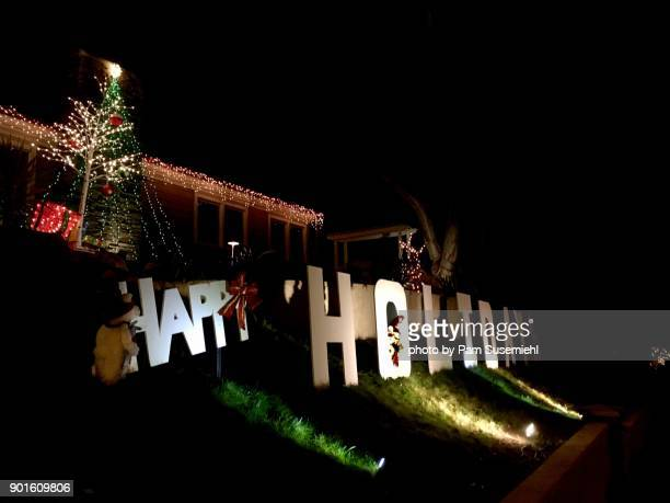 front yard happy holidays sign & christmas tree, night - happy holidays stock photos and pictures