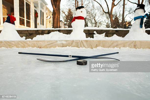 front yard home hockey rink minneapolis, minnesota - center ice hockey player stock pictures, royalty-free photos & images