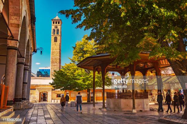front yard of gazi husrev-beg mosque in sarajevo, bosnia and hercegovina - bosnia and hercegovina stock pictures, royalty-free photos & images