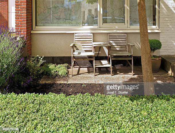 Front yard with chairs and plants in Delft Holland