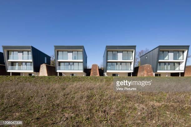 Frontal elevation of 4 of the houses. Priddys Hard, Gosport, United Kingdom. Architect: John Pardey Architects, 2019.