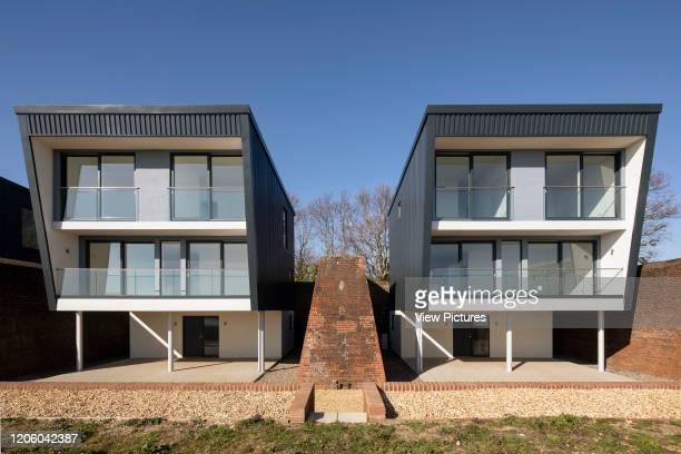 Frontal elevation of two of the houses. Priddys Hard, Gosport, United Kingdom. Architect: John Pardey Architects, 2019.