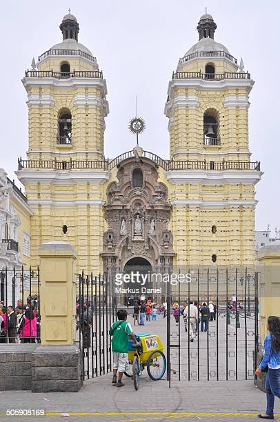 Frontal view of the church basilica and convent of San Francisco located in old historic downtown Lima, Peru on a typical overcast day. Under this...