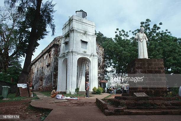 Frontal view of the ruins of Saint Paul's Church. Originally built by the Portugese in 1571. Statue is of Francis Xavier..