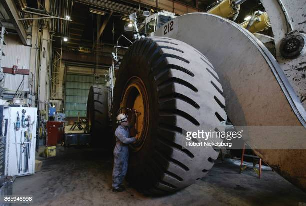 A frontend bucket loader capable of moving 46 tons with one pass has its wheel worked on by a mechanic at the Buckskin Coal Mine 12 miles north of...