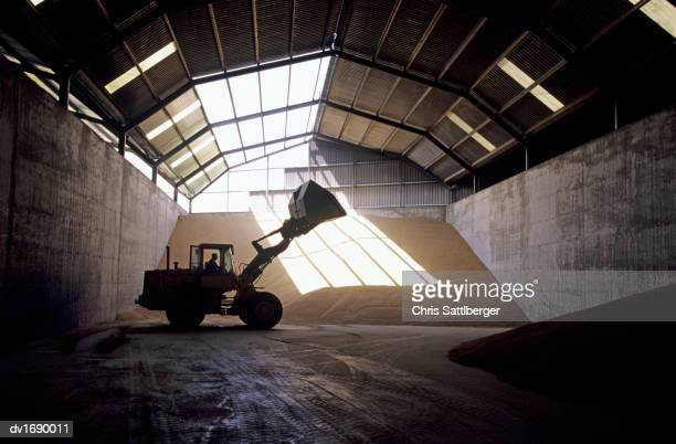 Front-end loader in grain warehouse