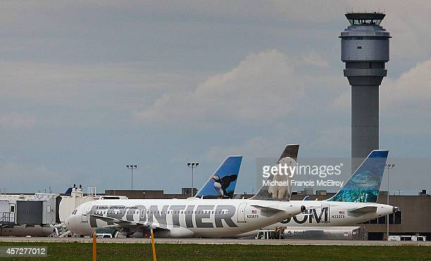 Frontier Airlines plane is parked at a gate at Cleveland Hopkins Airport on October 15 2014 in Cleveland Ohio Recently diagnosed Ebola patient health...