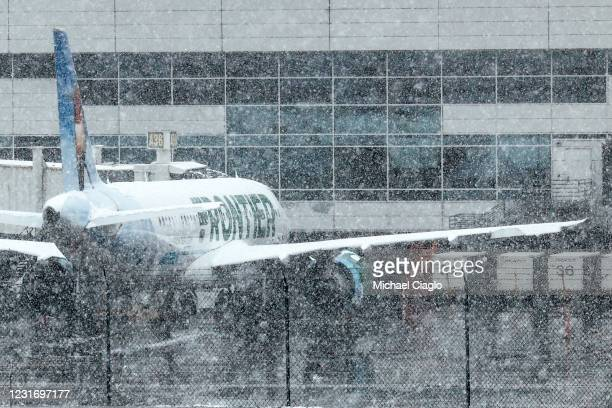 Frontier Airlines plane sits at a gate at Denver International Airport on March 13, 2021 in Denver, Colorado. More than 1800 flights into and out of...