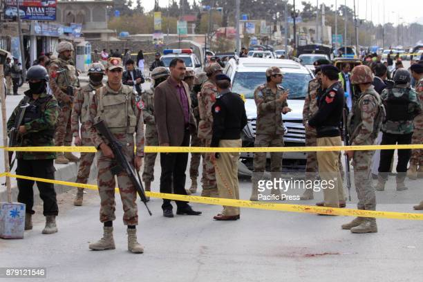 QUETTA BALOCHISTAN PAKISTAN Frontier corps security officials and rescue workers inspect the scene of bomb blast A suicide bomber targeted Frontier...