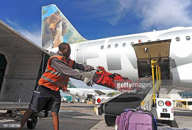 FRONTIER01 Frontier's Ryan Brown a baggage handler loads a plane on Thursday at DIA It was business as usual for employees at Frontier on the day...