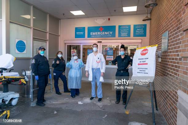 Frontline hospital workers pose in front of emergency room at Maimonides Medical Center in Brooklyn where patients for COVID19 have been treated