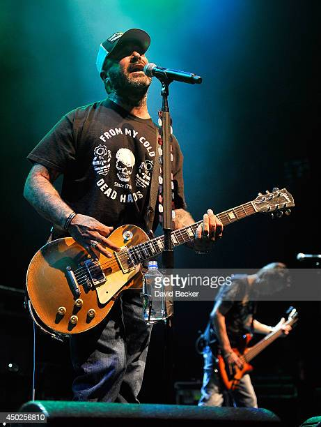 Frontman Aaron Lewis and bassist Johnny April of Staind perform at The Pearl concert theater at the Palms Casino Resort on June 7 2014 in Las Vegas...