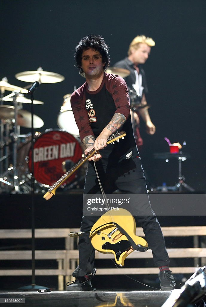 Frontman Billie Joe Armstrong of Green Day smashes his guitar as he performs onstage during the 2012 iHeartRadio Music Festival at the MGM Grand Garden Arena on September 21, 2012 in Las Vegas, Nevada.