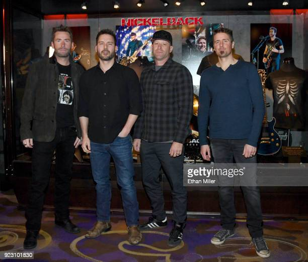 Frontman Chad Kroeger guitarist Ryan Peake bassist Mike Kroeger and drummer Daniel Adair of Nickelback attend a memorabilia case dedication ahead of...