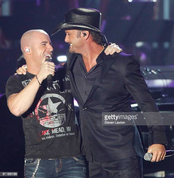Frontman Chris Daughtry from the band Daughtry and recording artist Tim McGraw perform at the 14th annual Andre Agassi Charitable Foundation's Grand...