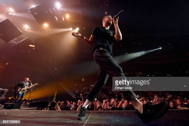 Frontman Dan Reynolds and bassist Ben McKee of Imagine Dragons perform during a stop of the band's Evolve World Tour at TMobile Arena on September 29...