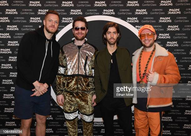 Frontman Dan Reynolds drummer Daniel Platzman guitarist Wayne Sermon and bassist Ben McKee of Imagine Dragons pose during a meetandgreet with fans at...