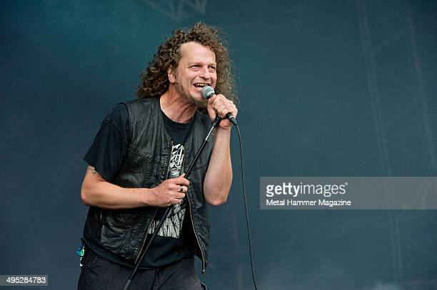 Frontman Denis Belanger of Canadian progressive metal group Voivod performing live on stage at Bloodstock Open Air festival in Derbyshire England on...