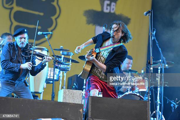 Frontman Eugene Hutz and violinist Sergey Ryabtsev of Gypsy punk group Gogol Bordello performing live on the Zippo Encore Stage at Download Festival...
