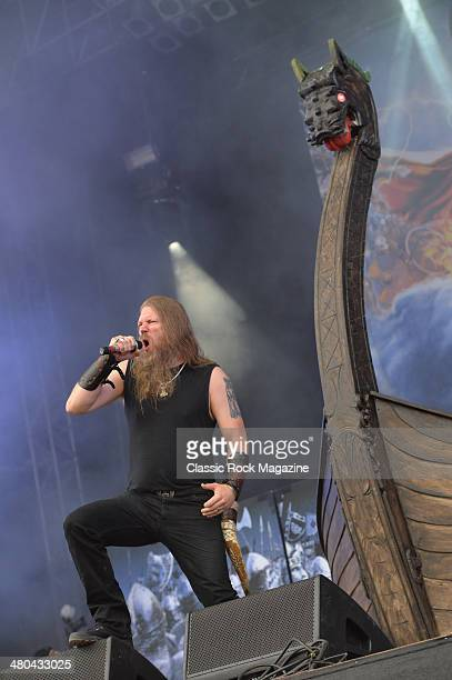 Frontman Johan Hegg of Swedish death metal group Amon Amarth performing live on the Zippo Encore Stage at Download Festival on June 16 2013