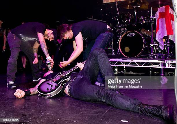Frontman Matt Heafy of Trivium led onstage with Rob Flynn of Machine Head and Austin Dickinson of Rise To Remain at the Golden Gods Awards June 15...