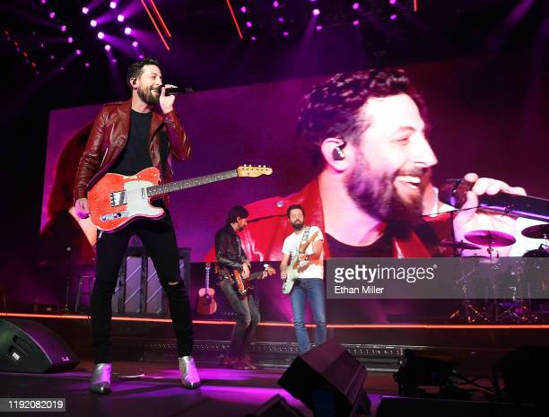 Frontman Matthew Ramsey bassist Geoff Sprung and guitarist Brad Tursi of Old Dominion perform during a stop of the band's Make It Sweet Tour at The...
