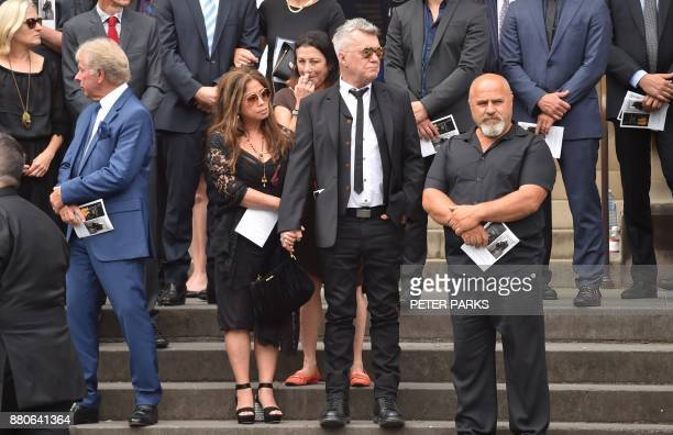 Frontman of Australian rock band Jimmy Barnes stands outside St Mary's Cathedral after the funeral service for AC/DC cofounder Malcolm Young in...