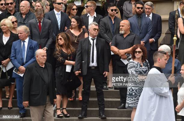Frontman of Australian rock band Jimmy Barnes stands with others outside St Mary's Cathedral after the funeral service for AC/DC cofounder Malcolm...