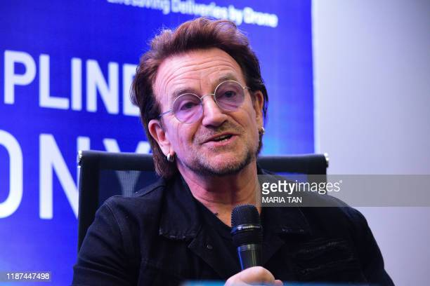Frontman singer Bono speaks to the media during a signing ceremony in Manila on December 10, 2019.