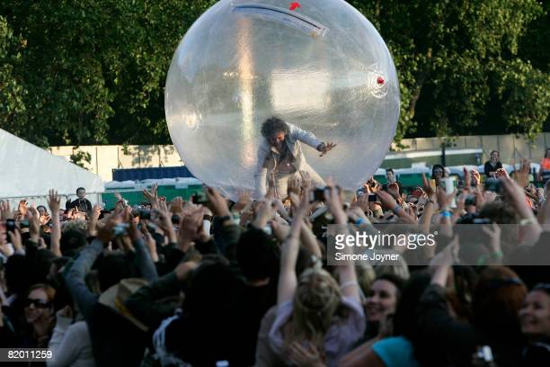 Frontman Wayne Coyne of The Flaming Lips surfs the crowd in a giant transparent ball during day two of the Love Box Weekender at Victoria Park on...