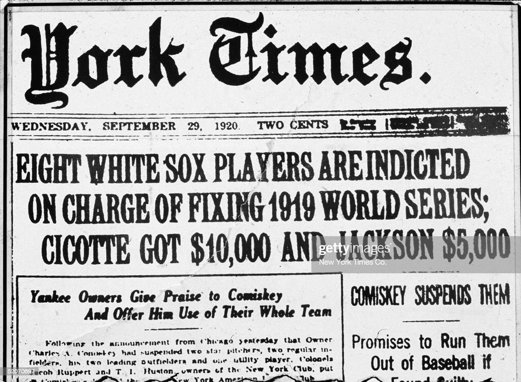Frontpage headline of the New York Times newspaper describing the so-called 'Black Sox' scandal in which players of the American League's Chicago White Sox threw the World Series reads 'Eight White Sox players are indicted on charge of fixing 1919 World Series; Cicotte got $10,000 and Jackson $5,000. Comiskey suspends them; Promises to run them out of baseball if found guilty,' September 29, 1920. Inset headline reads 'Yankee owners give praise to Comiskey and offer him use of their whole team.' Charles A. Comiskey was the owner of the White Sox. Pitcher Eddie Cicotte and left fielder 'Shoeless' Joe Jackson were popular and successful players involved in the scandal.