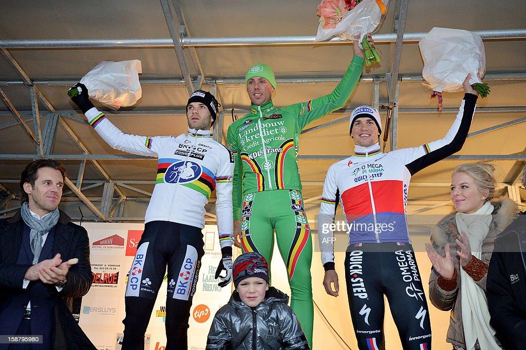 Frontrunner Sven Nys of Belgium (C), 2nd place winner Niels Albert of Belgium (L), and 3rd place winner Zdenek Stybar of the Czech Republic celebrate on the podium after the 'Versluys Ereprijs Paul Herygers' sprint cyclocross race in Bredene, on December 29, 2012. QFP