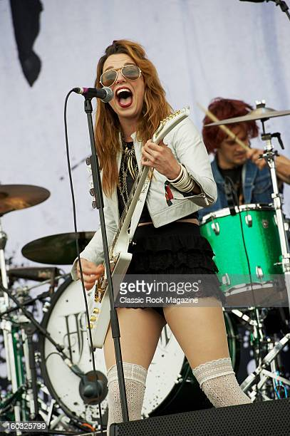 Frontwoman Lzzy Hale of American hard rock group Halestorm performing live on the Zippo Encore Stage at Download Festival on June 9 2012