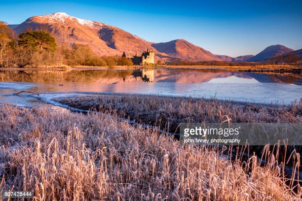 Frost and Ice on Loch Awe with with Kilchurn Castle at sunrise, Scotland. UK.