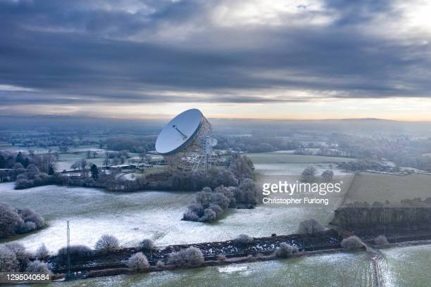 Frost clings to trees near the Lovell telescope at Jodrell Bank on January 07, 2021 in Holmes Chapel, United Kingdom. Snow showers and freezing fog...
