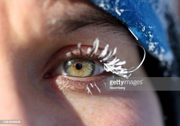 Frost coats a jogger's eyelashes as an extreme cold warning is issued in Winnipeg Manitoba Canada on Friday Jan 18 2019 Bitterly cold wind chill...