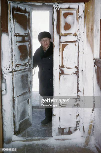Frost coats the inside of a second door to a building Many buildings in Siberia have an airlock of two doors Even so frost accumulates on the inside...
