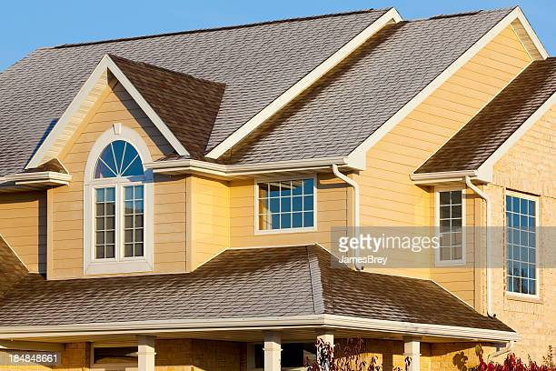 frost covered house with brick, vinyl siding - cedar tree stock photos and pictures