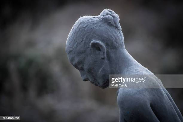 Frost gathers on a statue on a canal boat on the Kennet and Avon canal on December 12 2017 near Bath England Last night the UK had the coldest night...