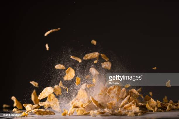 frosted corn cereal caputred in high speed - crunchy stock pictures, royalty-free photos & images