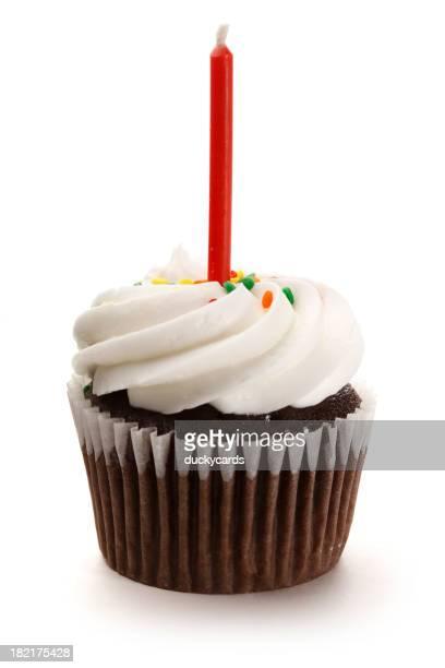 Petit gâteau avec une bougie dépoli