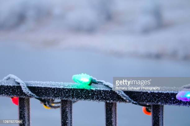 frost covered christmas lights deck porch