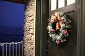 frost christmas wreath hanging front door