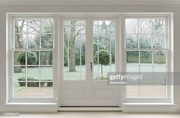 frosty view through white windows - window frame stock pictures, royalty-free photos & images