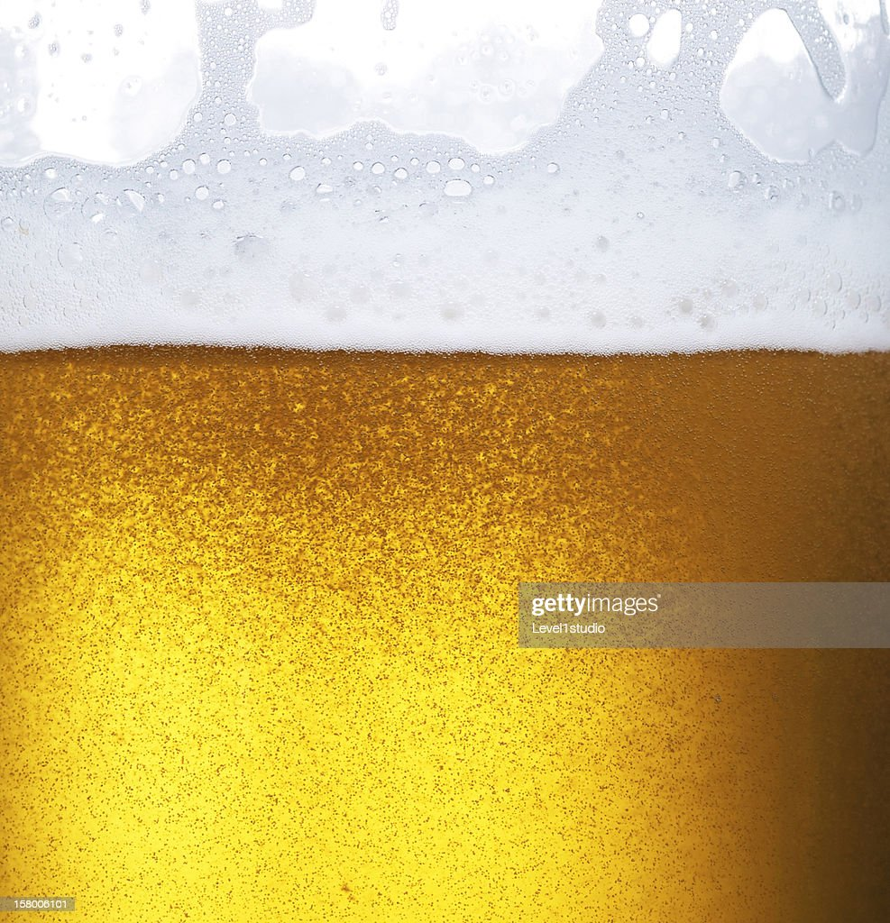 Froth on beer : Stock Photo