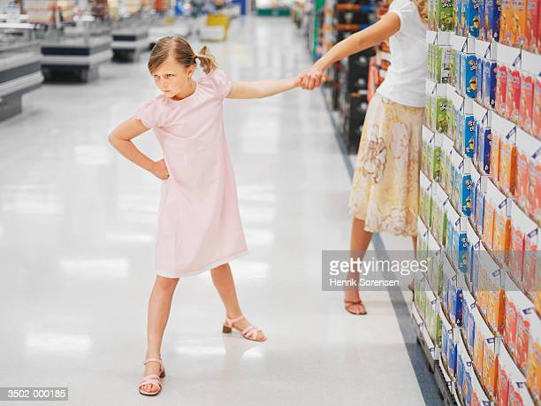 Frowning Girl in Supermarket
