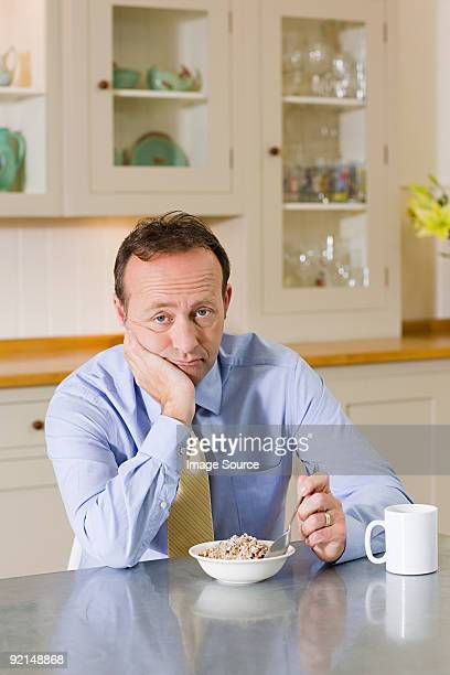 Frowning man with breakfast