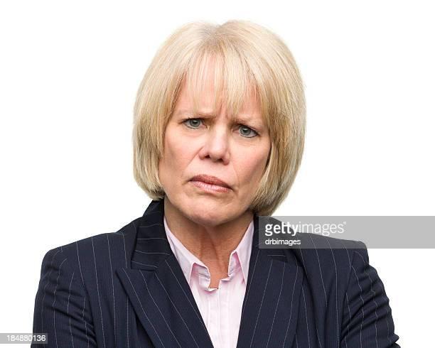 Frowning Mature Woman Looking at Camera