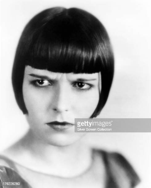 A frowning portrait of American silent film actress Louise Brooks circa 1929